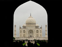 Taj Mahal through Entrance Arch. One of the most beautiful wonders of the world Stock Image