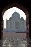 Taj Mahal framed in arch, Agra, Uttar Pradesh, Ind Stock Photos