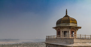 Taj mahal. A historic building overlooking the Taj Mahal in the distance Royalty Free Stock Photography