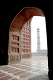 Taj Mahal from inside mosque. View of Taj Mahal minaret from inside Mosque, Agra, India Royalty Free Stock Images