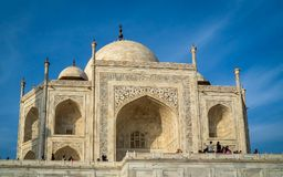 The Taj Mahal is an ivory-white marble mausoleum on the south bank of the Yamuna river stock image