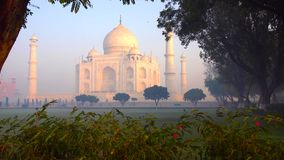 The Taj Mahal is an ivory-white marble mausoleum on the south bank of the Yamuna river in the Indian city of Agra, Uttar Pradesh stock image