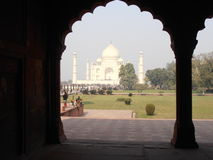 Taj Mahal. Looking through an accompanying building with decorative arches Royalty Free Stock Photo