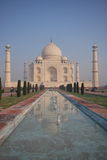 Taj Mahal. The magnificent Taj Mahal of India, reflected in a still pool with a blue sky backdrop stock images