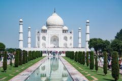 The Taj Mahal is one of the seven wonders and a magnificent world famous tourist attraction and landmark in India. The Taj Mahal is a mausoleum built to honor royalty free stock photography