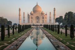 Taj Mahal at Sunrise, Agra, Uttar Pradesh, India. The Taj Mahal meaning Crown of the Palace is an ivory-white marble mausoleum on the south bank of the Yamuna Stock Photos