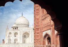 Taj Mahal and mosque in India. Taj Mahal tomb and mosque in the arch at blue sky in Agra, Uttar Pradesh, India Stock Images