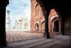 Taj Mahal and mosque in India. Taj Mahal tomb and mosque in the arch at blue sky in Agra, Uttar Pradesh, India Stock Image