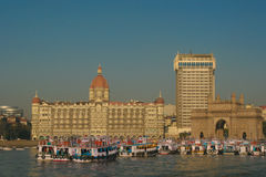 Taj Mahal Palace Hotel and India Gateway. Jan. 19, 2005 Mumbai, India - Taj Mahal Palace Hotel, Mumbai Waterfront, and Gateway Arch as they appeared in 2005 Royalty Free Stock Photo