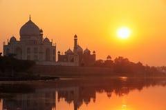 Taj Mahal reflected in Yamuna river at sunset in Agra, India Royalty Free Stock Image