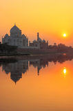 Taj Mahal reflected in Yamuna river at sunset in Agra, India Royalty Free Stock Photography