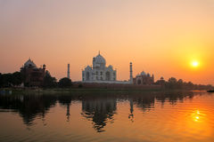 Taj Mahal reflected in Yamuna river at sunset in Agra, India Royalty Free Stock Images