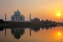 Taj Mahal reflected in Yamuna river at sunset in Agra, India