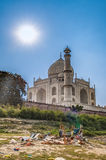 Taj Mahal in sun light. Early in the morning, back view behind the fence, from outside, river side. One of the most. Taj Mahal in sun light with a little indian Royalty Free Stock Image