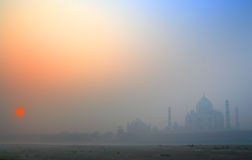 Taj Mahal at sunrise in fog Stock Photo