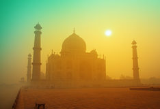 Taj Mahal at sunrise in fog Stock Photos