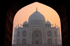 Taj Mahal at sunrise framed with the arch of the mosque, Agra, U Royalty Free Stock Images
