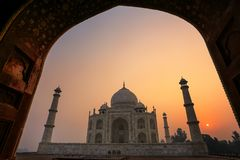 Taj Mahal at sunrise framed with the arch of the mosque, Agra, U royalty free stock photography