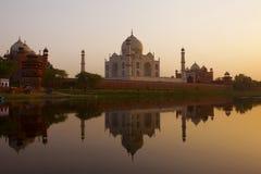 Taj Mahal sunrise silhouette. Sunrise silhouette of the Taj Mahal from the western gate Stock Photos