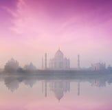 Taj Mahal on sunrise sunset, Agra, India. Taj Mahal on sunrise sunset reflection in Yamuna river panorama in fog, Indian Symbol - India travel background. Agra Stock Image