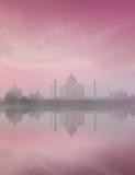 Taj Mahal on sunrise sunset, Agra, India. Taj Mahal on sunrise sunset reflection in Yamuna river panorama in fog, Indian Symbol - India travel background. Agra Royalty Free Stock Photo