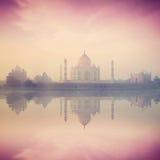 Taj Mahal on sunrise sunset, Agra, India. Vintage retro hipster style image of Taj Mahal on sunrise sunset reflection in Yamuna river panorama in fog, Indian Royalty Free Stock Image