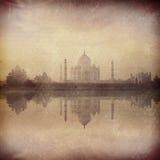 Taj Mahal on sunrise sunset, Agra, India. Vintage retro hipster style image of Taj Mahal on sunrise sunset reflection in Yamuna river panorama in fog, Indian Stock Photo