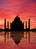 Taj Mahal sunset. Evocation of Taj Mahal, marvel of architecture, reflecting in water outlined at sunset. Near Agra, India stock illustration