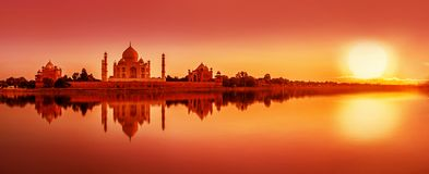 Taj Mahal during sunset in Agra, India. Panoramic view of Taj Mahal during sunset reflected in the Yamuna river, in Agra , Uttar Pradesh, India stock photo