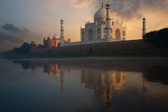 Taj Mahal Sunset from Jamuna River. The Taj Mahal glows brilliantly from a colorful sunset seen from the holy Jamuna river Stock Images