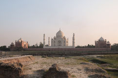 Taj Mahal view from across the Yamuna river. Taj Mahal, the marble mausoleum with four minarets and two red sandstone buildings on either side of the mausoleum Royalty Free Stock Photos