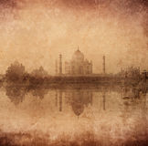 Taj Mahal. Vintage retro hipster style image of Taj Mahal with reflection in Yamuna river panorama in fog, Indian Symbol - India travel background with grunge Stock Photos