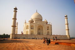 Taj Mahal. The Taj Mahal is a white marble mausoleum located on the southern bank of Yamuna River in the Indian city of Agra. It was commissioned in 1632 by the Stock Photos
