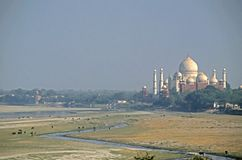 Taj Mahal and the Yamuna River. This image was shot in Agra, India and shows the Taj Mahal and the Yamuna River as seen from Agra Fort. The image was shot with a Stock Photography