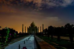 Taj viewing under a full moon. The tourism department of India regularly permits visitors to view the Taj on full moon nights. In This picture is backlit with Royalty Free Stock Photo