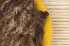 Tajadas de cerdo asadas a la parilla imagen de archivo