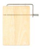 Tajadera de madera con el cortador de queso Imágenes de archivo libres de regalías