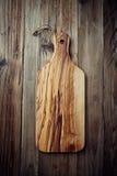 Tajadera de madera verde oliva Foto de archivo libre de regalías