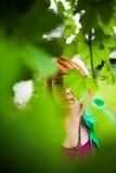 Tajemnicza kobieta za liśćmi zdjęcie royalty free