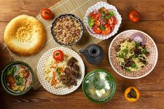 Tajik cuisine. Traditional assorted Tajik dishes, Top view royalty free stock photos