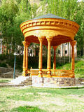 Tajik national carved wooden gazebo. In the Garm Chashma Mountainous Badakhshan region of Tajikistan Stock Image
