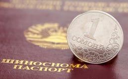 Tajik one somoni coin against the background of the passpo Royalty Free Stock Photo