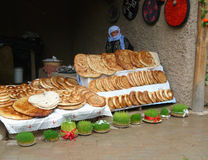 Tajik woman demonstrates tortillas Stock Photography