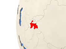 Tajikistan on 3D globe. Map of Tajikistan on globe with watery blue oceans and landmass with visible country borders. 3D illustration Royalty Free Stock Image