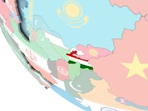 Tajikistan with flag on globe. Tajikistan on bright political globe with embedded flag. 3D illustration Stock Image