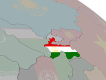 Tajikistan with flag. Highlighted on model of globe. 3D illustration Royalty Free Stock Images
