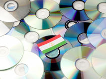 Tajikistan flag on top of CD and DVD pile isolated on white. Tajikistan flag on top of CD and DVD pile isolated Stock Photos