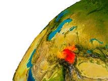 Tajikistan on globe Stock Images