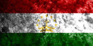 Tajikistan grunge flag on old dirty wall.  Stock Photography