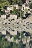 The Tajikistan nature. Tajikistan. Reflexion of clay houses from lake in Penjikent Stock Images